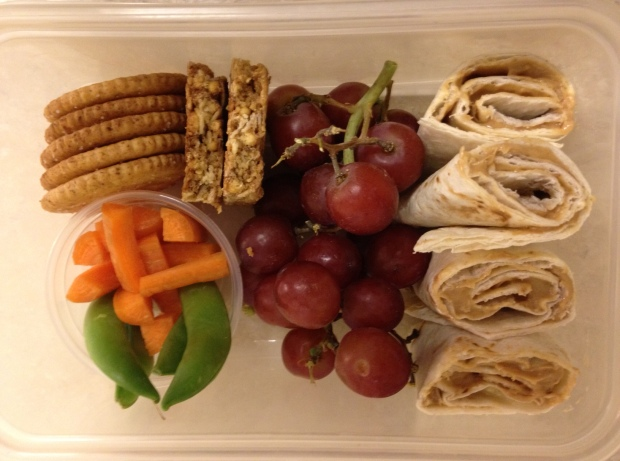 Gege's lunch for monday... Peanut butter and honey rollup, carrot sticks and snap peas, grapes, crackers and granola bar for dessert.
